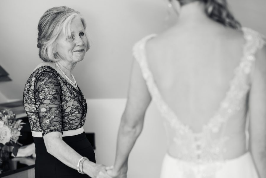 mother sees bride in dress