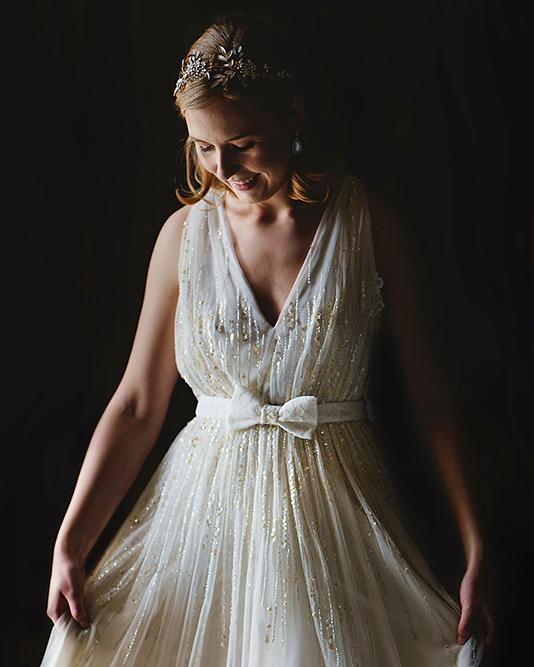 bride adjusting dress at st michaels manor
