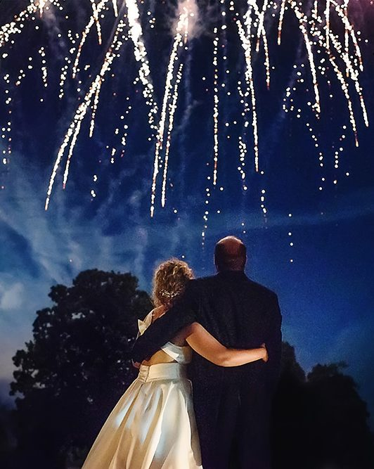 bride and groom watching fireworks at ashridge house