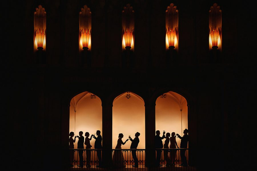 creative wedding photographer silhouette guests laughing