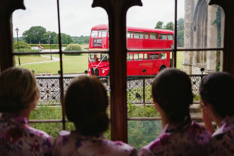 lodndon bus arrives to take guests to church