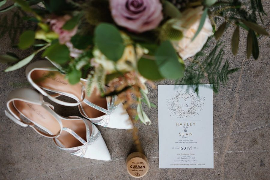 brides shoes invitation and bouquet