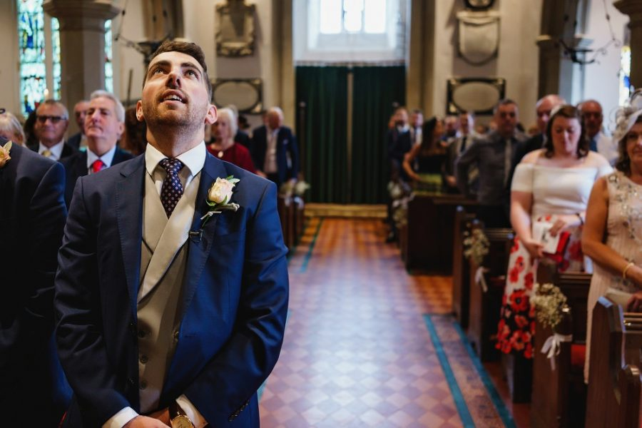 groom waiting for bride at church
