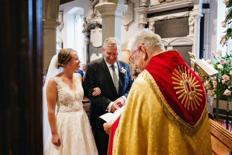 bride with father at church wedding