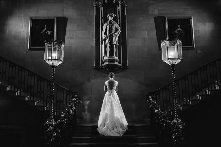 bride standing on staircase in hertfordshire manor house