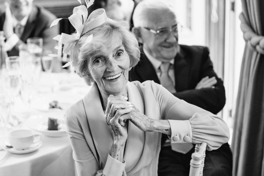 nan smiling at wedding speeches