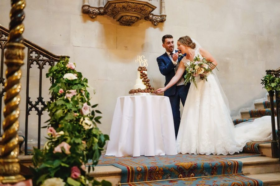 bride and groom cut the cake at ashridge house
