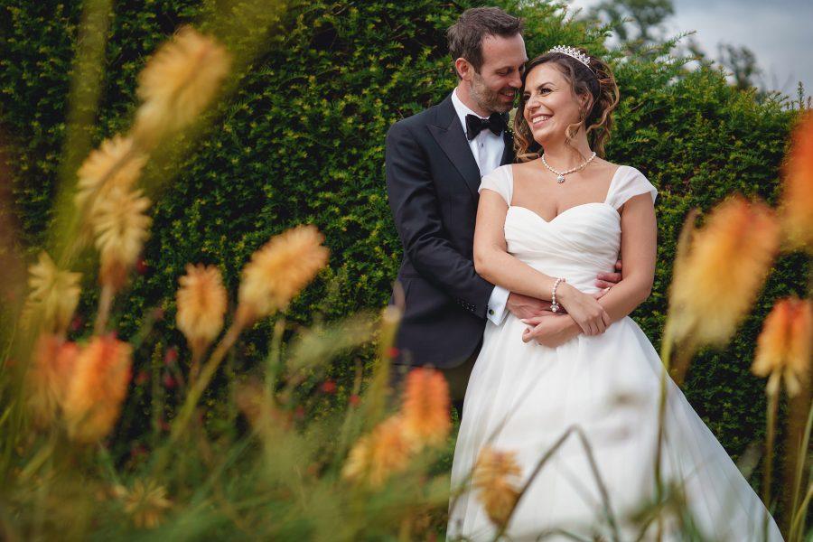 bride and groom cuddling at rickmansworth wedding venue