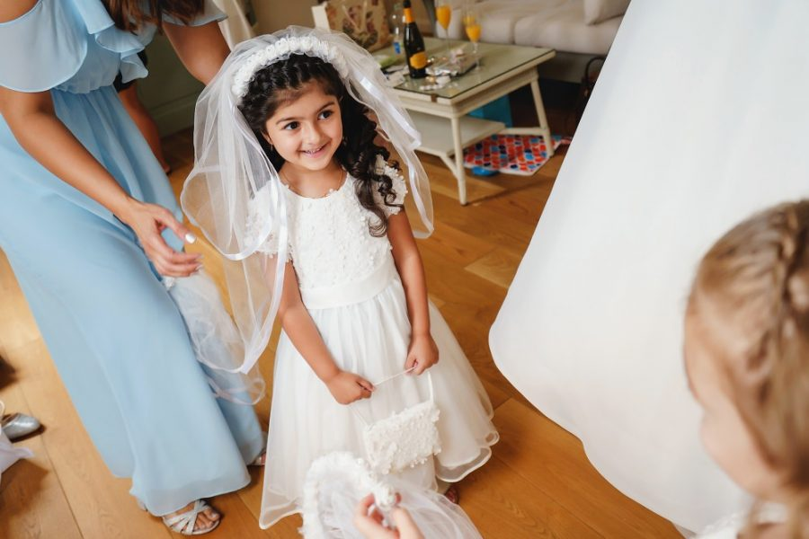 smiley flower girl with white dress
