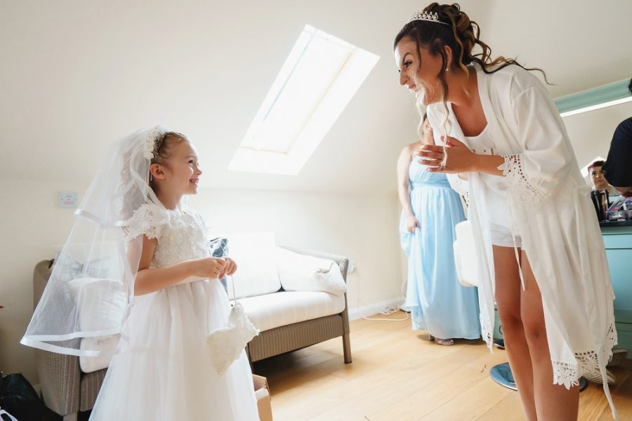 bride and flower girl excited before wedding