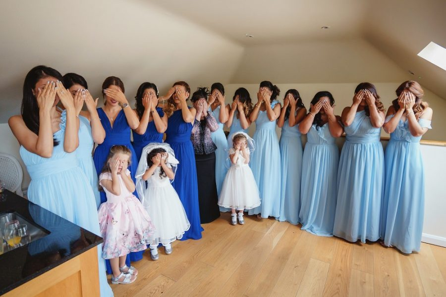 bridesmaids covering their eyes