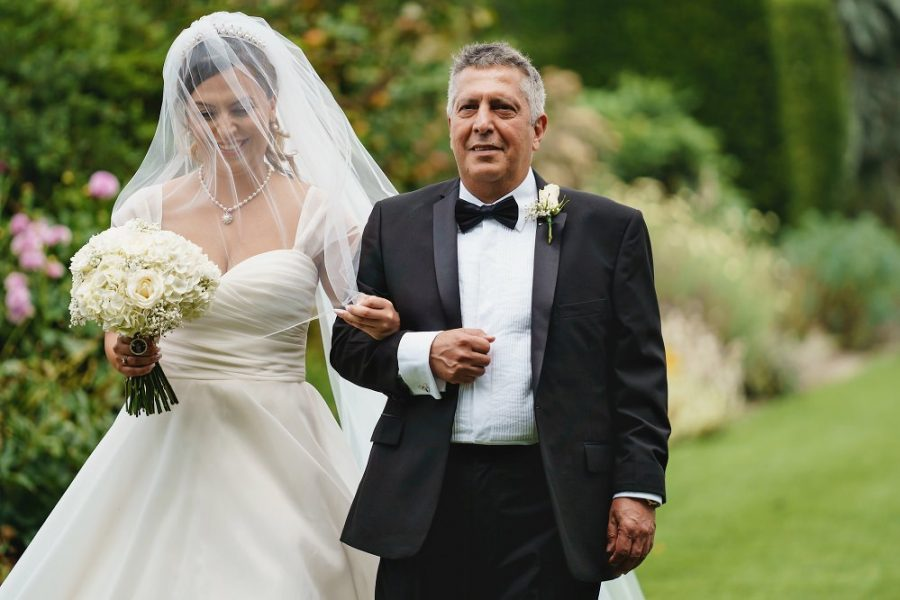 bride and dad walk down the aisle