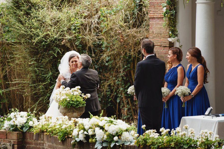 bride hugging dad during wedding ceremony