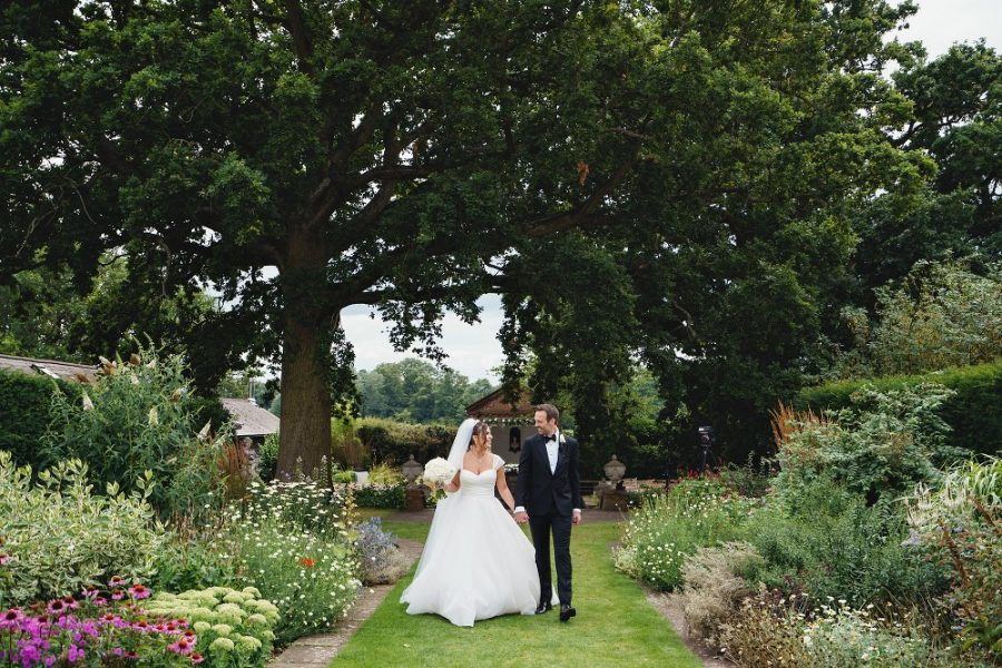 bride and groomwalking and holding hands