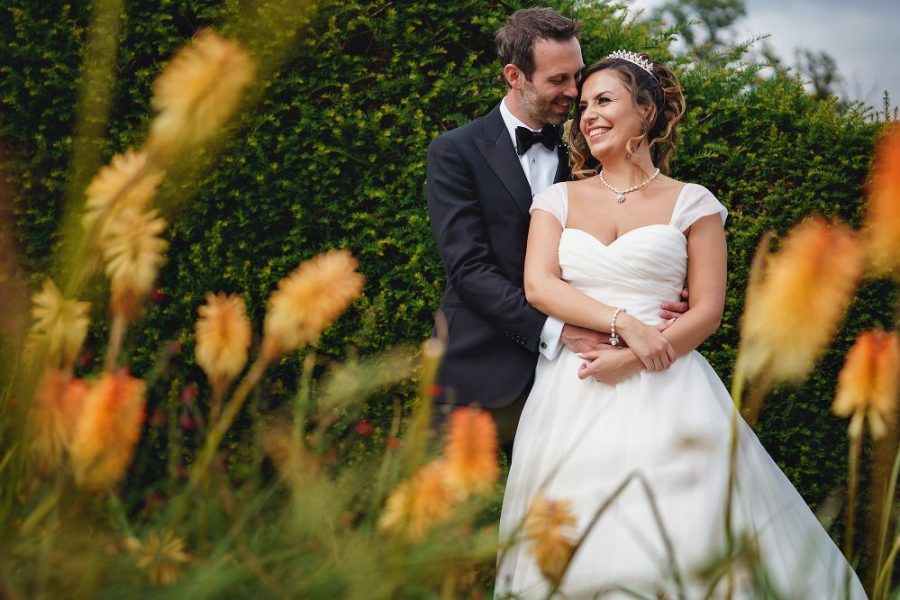 wedding couple in flowers at micklefield hall