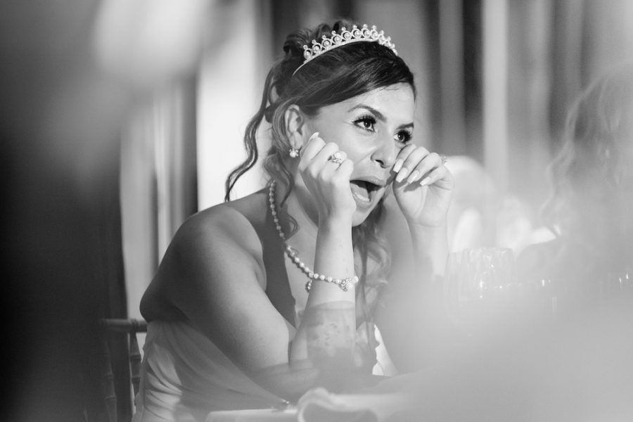 bride wiping a tear during speeches