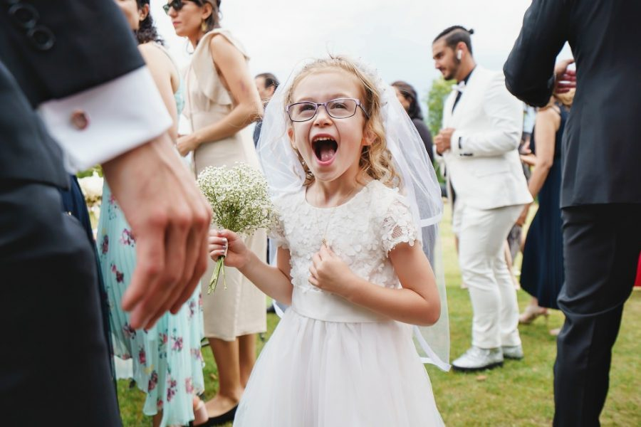 excited flower girl during wedding