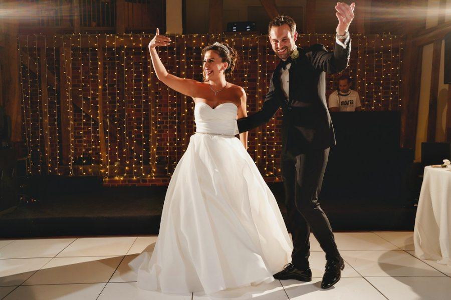 bride and groom get guests on the dancefloor