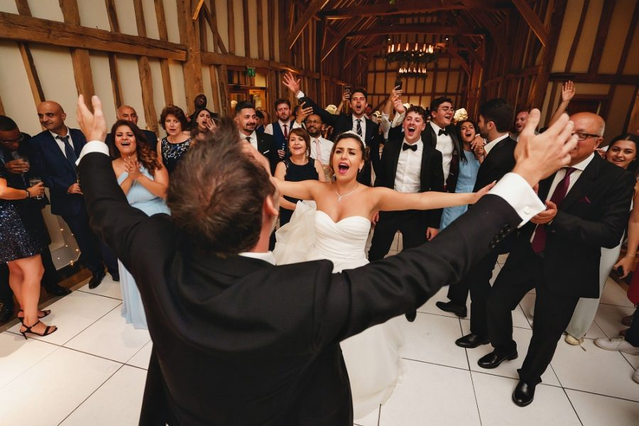 bride and groom singing at barn wedding