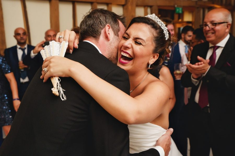 bride and groom hugging and laughing