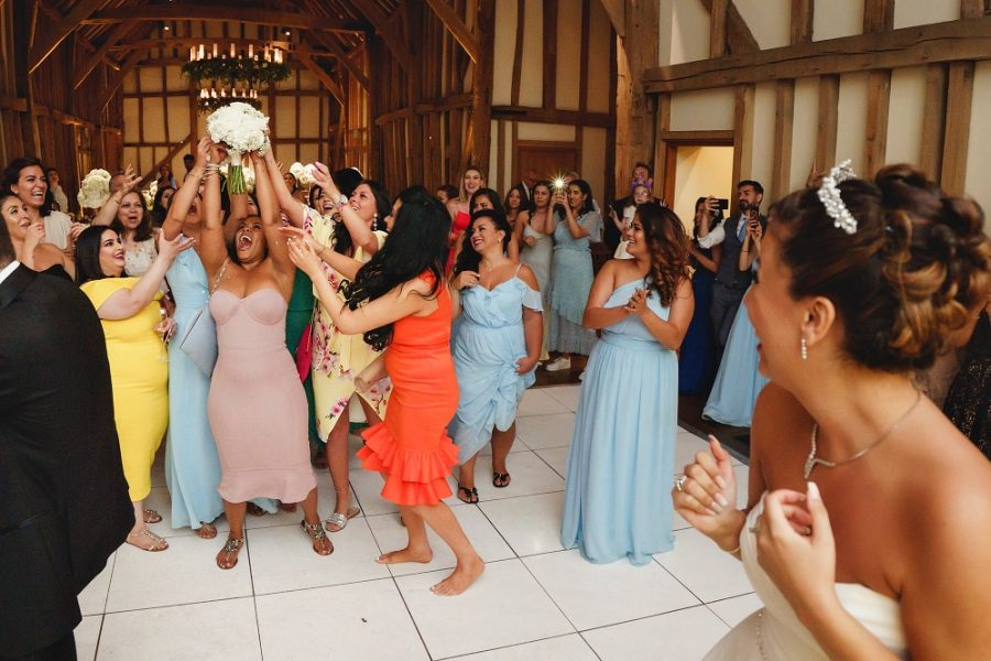bridesmaid catches the bouquet