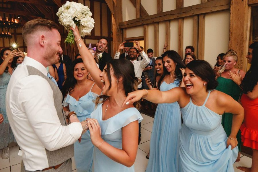 bridesmaid catches the bouquet