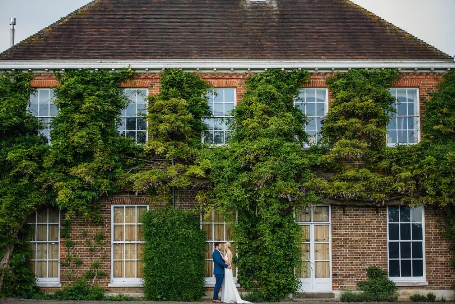 Bride and groom portrait at Micklefield Hall manor house