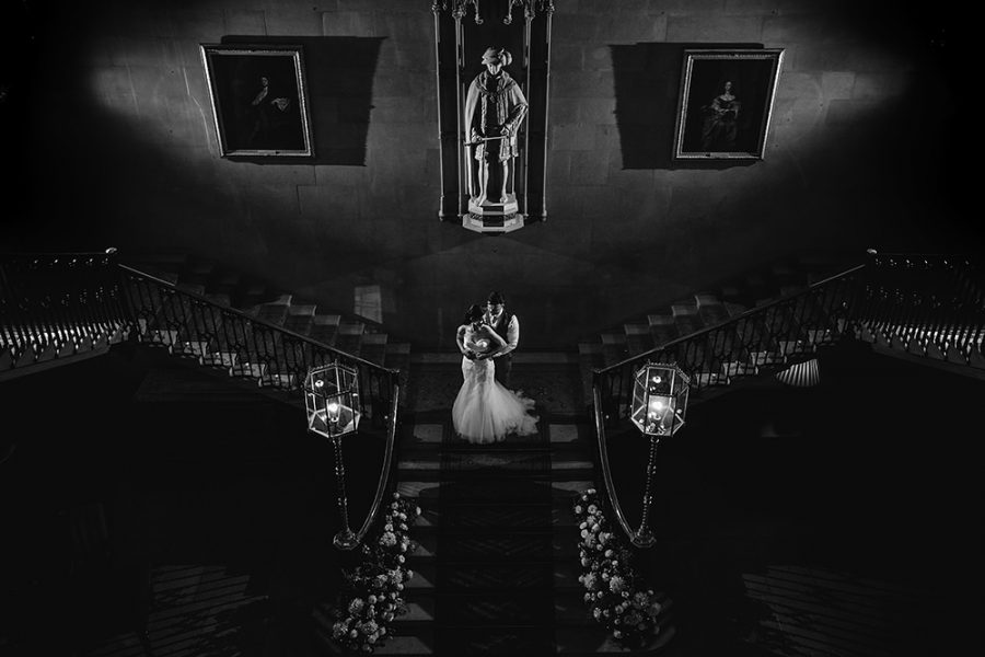 bride and groom on the stairs at Ashridge House