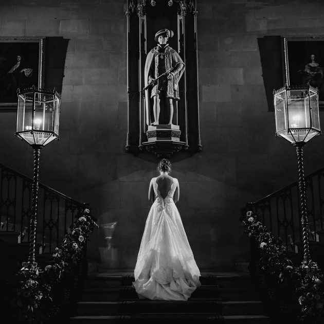 bride on staircase at country manor house in berkhamsted