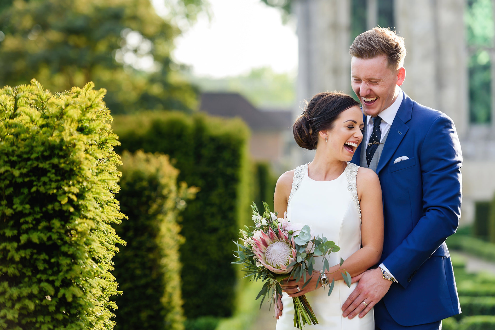 bride and groom laughing at berkhamsted wedding venue
