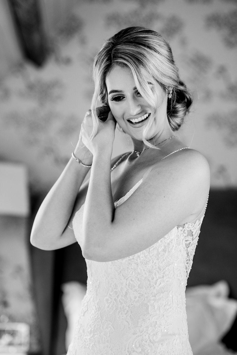 bride puts in her earrings