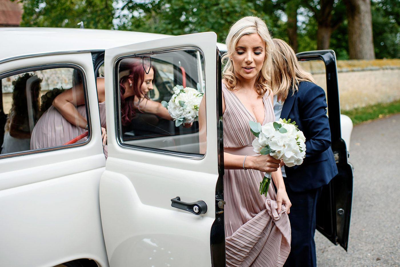 bridesmaids getting out of the car