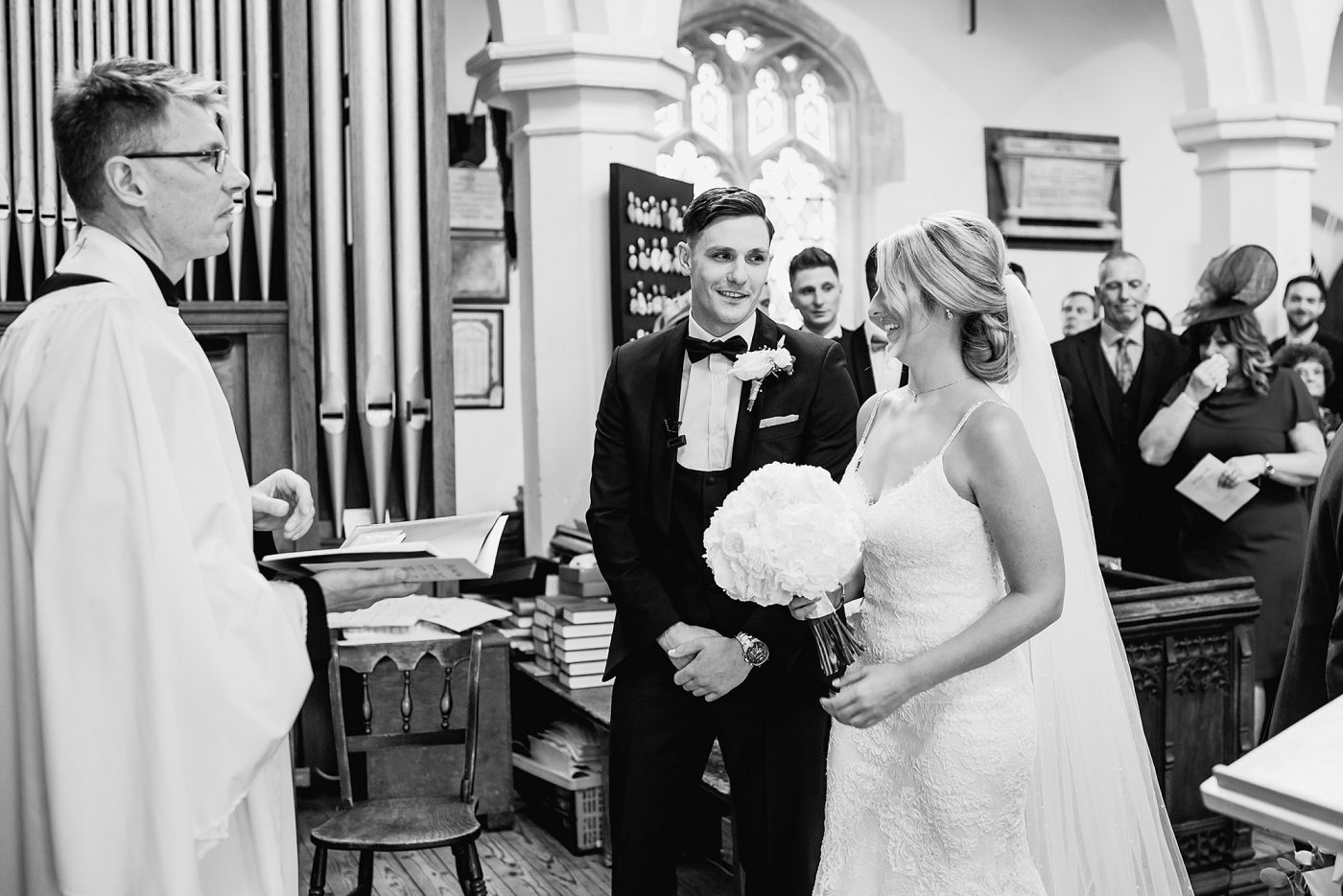 bride and groom smiling at eachother