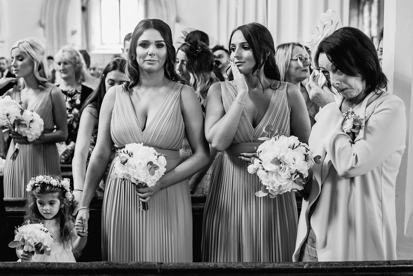 bridesmaid getting emotional during vows