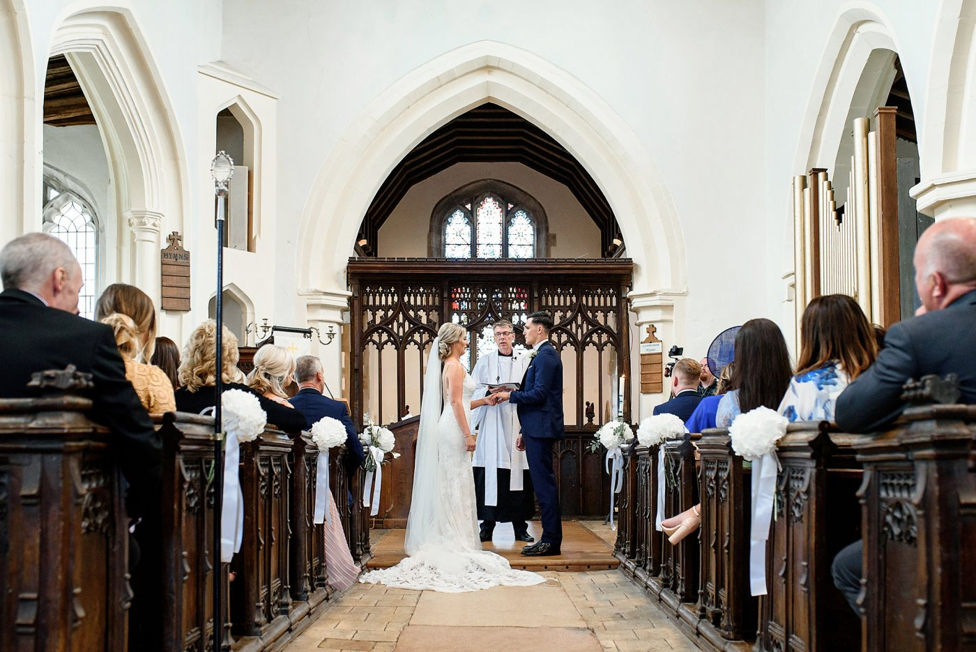 bride and groom getting married in st marys church