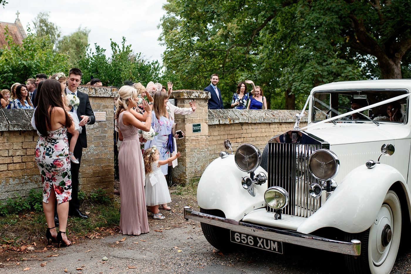 guests wave the couple off