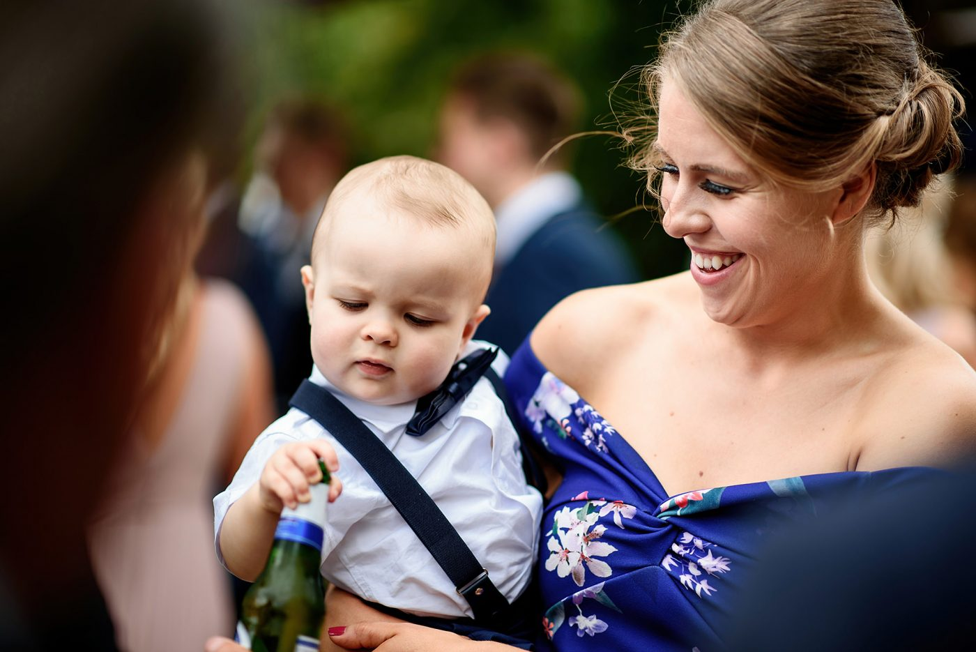 baby poking a beer bottle
