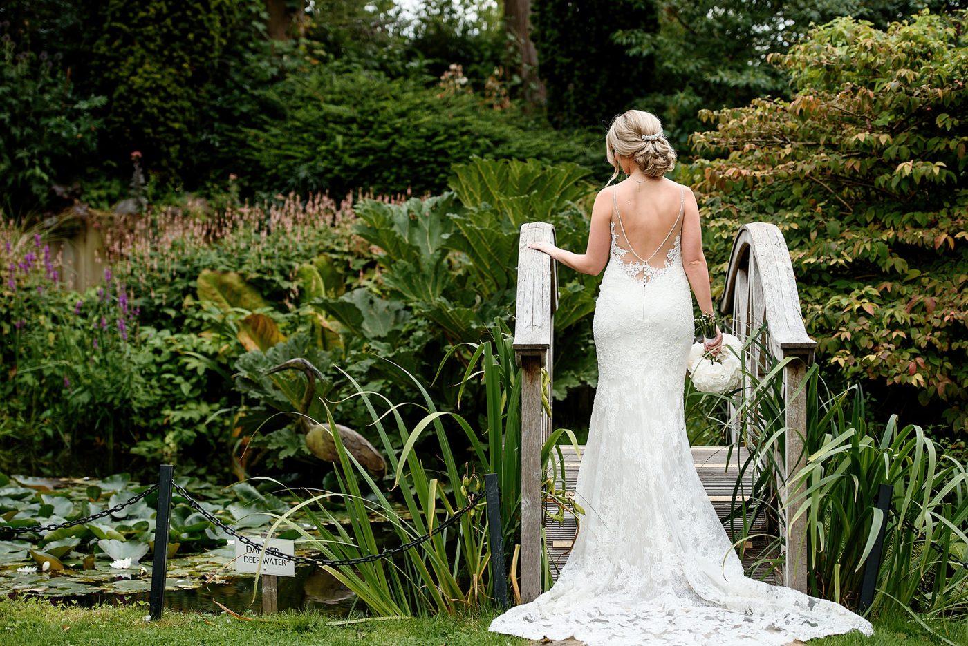 back of bride in enzoani wedding dress