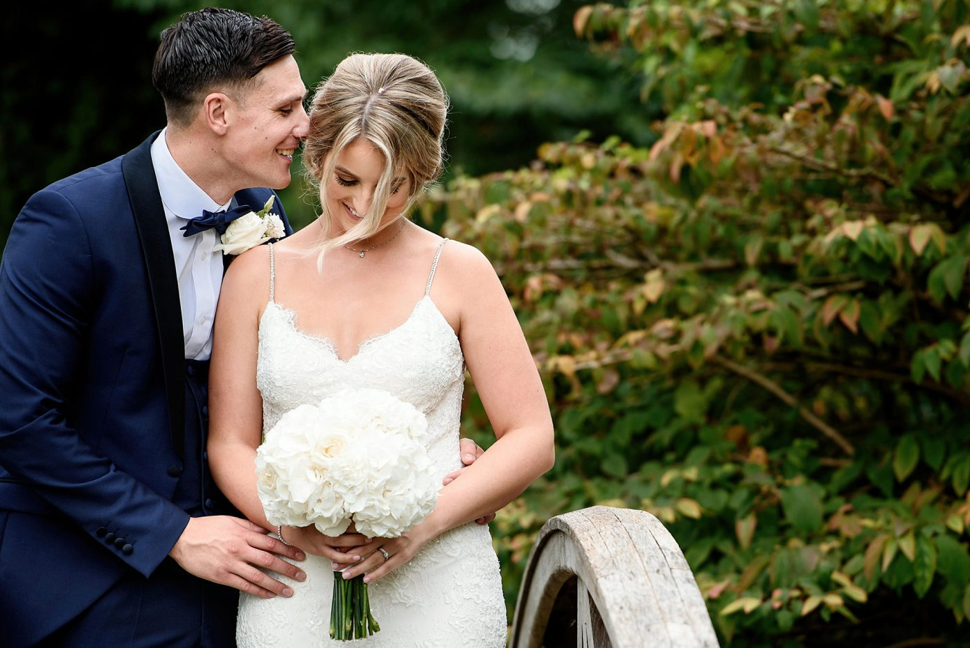 groom whispering into brides ear