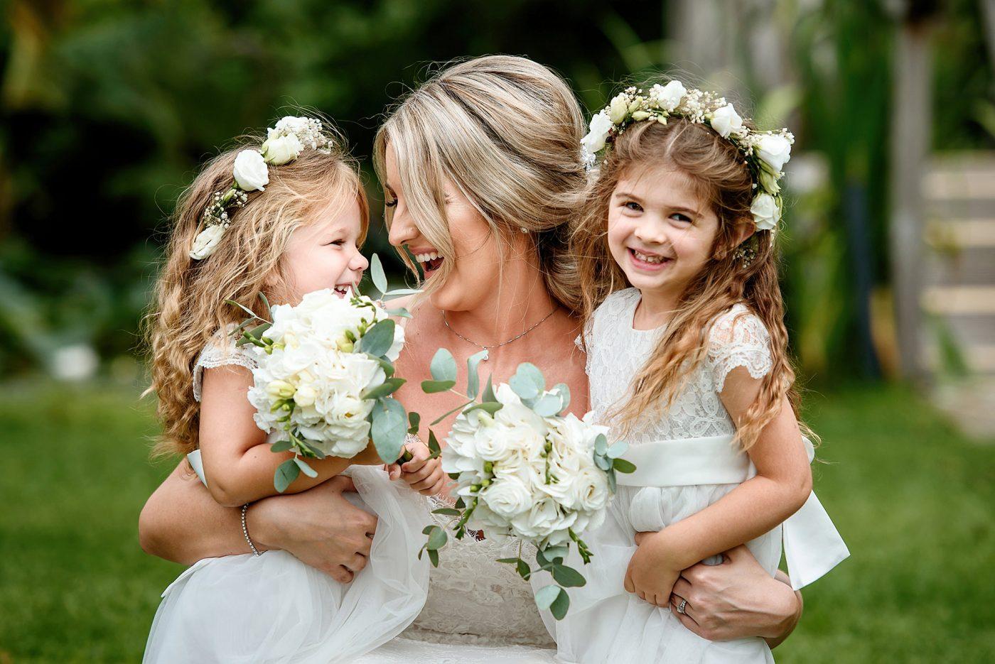 portrait of bride tickling flower girls