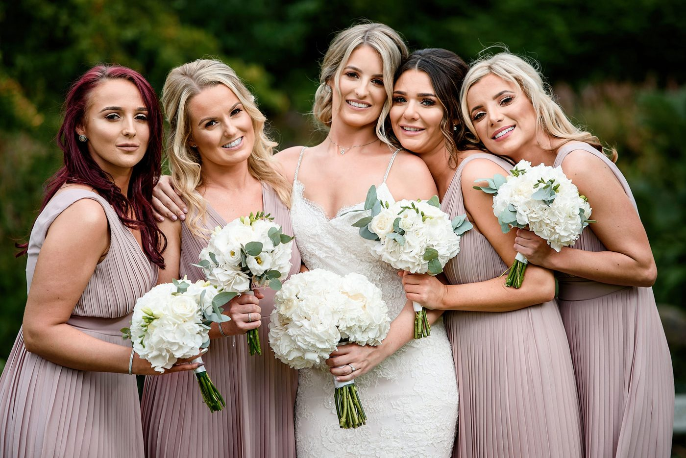 relaxed portraits of bridesmaid in pink blush wedding dresses