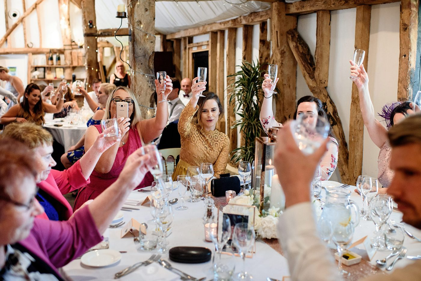 wedding guests toasting champagne glasses
