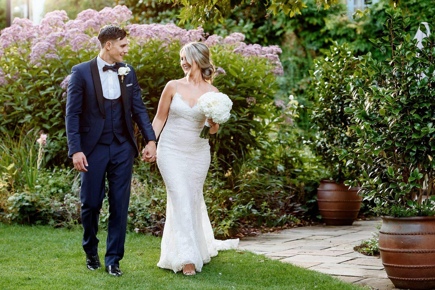 bride and groom walking at hertfordshire wedding venue