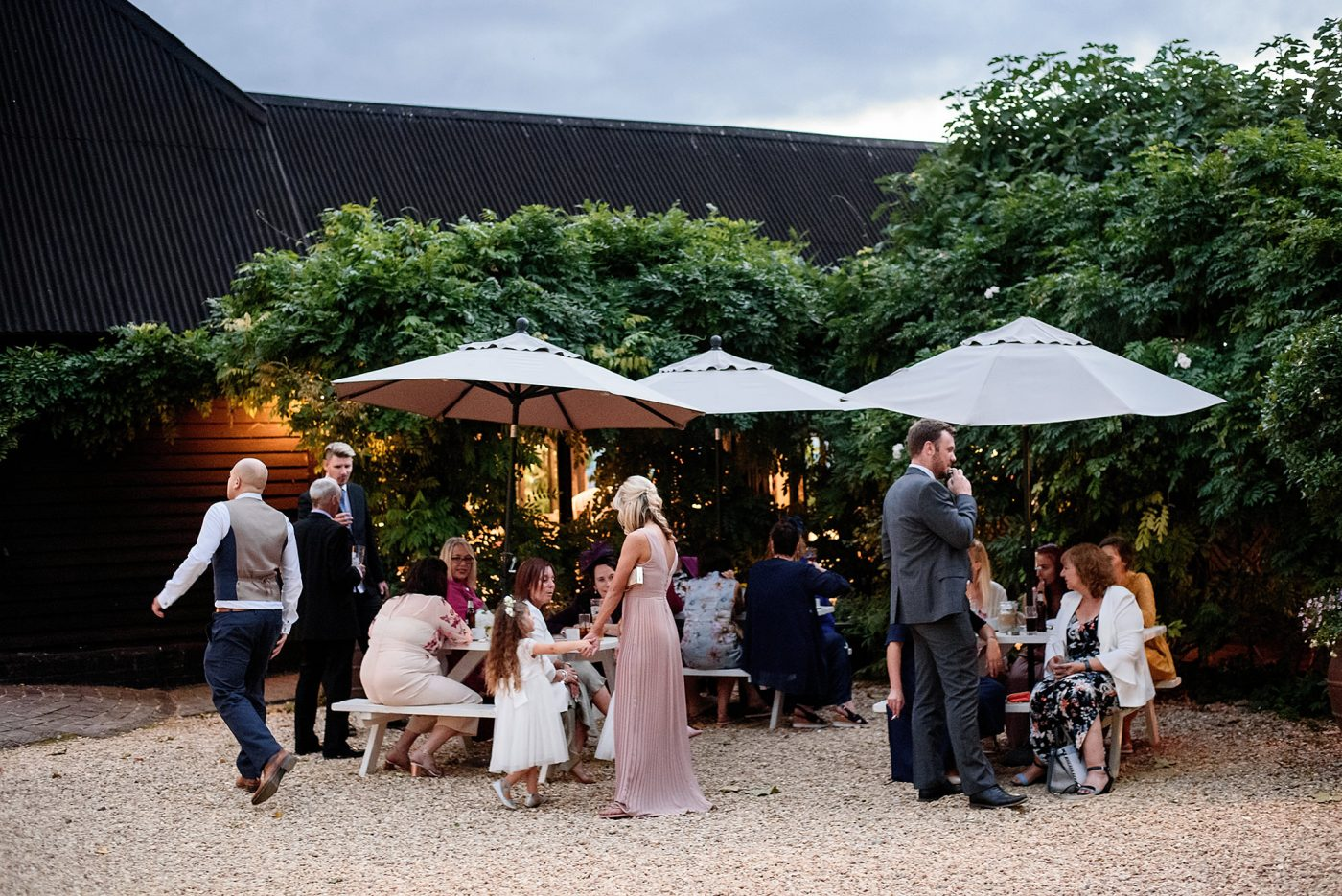 guests congregating outside the barn
