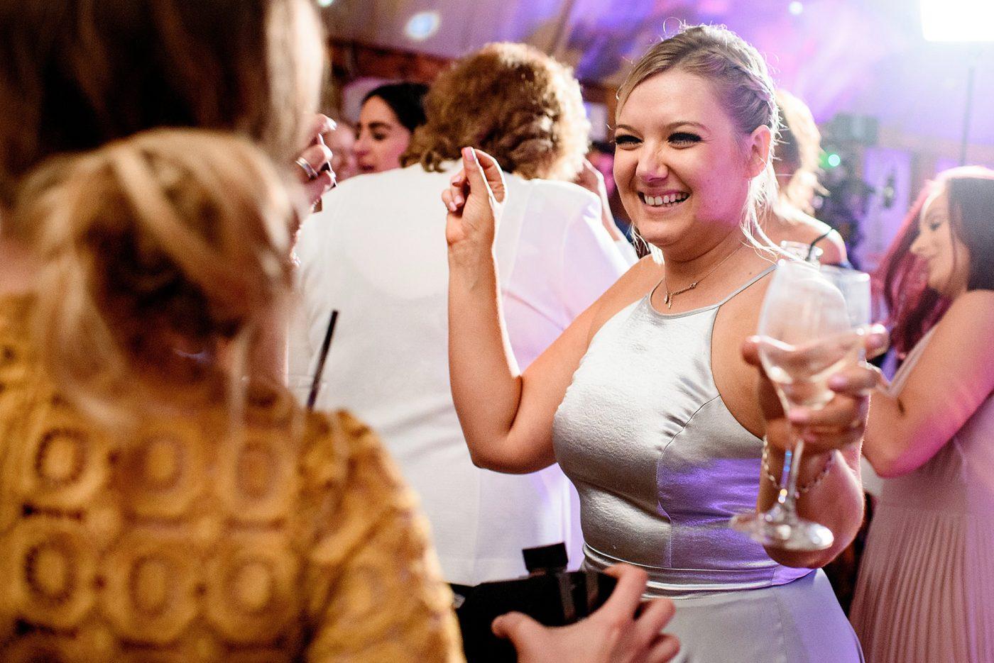 guest dancing at barn wedding venue